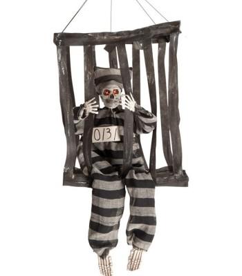 Squelette prisonnier en cage